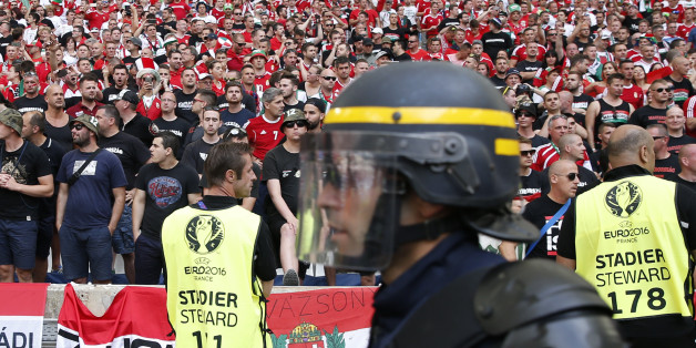 A French riot police officer walks past the Hungarian fans sector prior to the Euro 2016 Group F soccer match between Iceland and Hungary at the Velodrome stadium in Marseille, France, Saturday, June 18, 2016. Hungarian fans have clashed with stewards ahead of their team's game against Iceland at the European Championship. (AP Photo/Ariel Schalit)