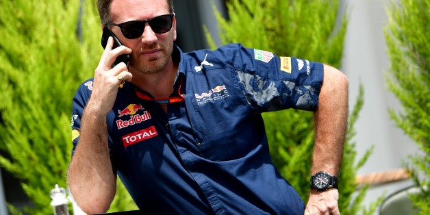 Infiniti Red Bull Racing's Team Chief Christian Horner speaks on his mobile phone in the paddock at the Baku City Circuit, on June 18, 2016 in Baku, before the third practice session for the European Formula One Grand Prix.  / AFP / ANDREJ ISAKOVIC        (Photo credit should read ANDREJ ISAKOVIC/AFP/Getty Images)