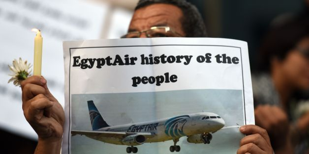 Egyptian journalists take part in a candle light vigil in memory of EgyptAir MS804 victims in front of the Journalists' Syndicate in Cairo on May 24, 2016. The Airbus A320 carrying 66 people crashed into the sea while flying from Paris to Cairo early May 19, 2016, and some wreckage but not the black boxes has been found.  / AFP / MOHAMED EL-SHAHED        (Photo credit should read MOHAMED EL-SHAHED/AFP/Getty Images)