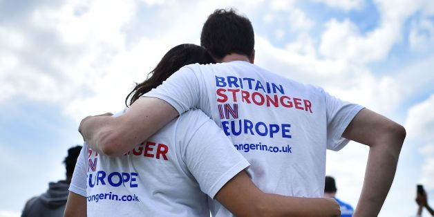 People wear 'Stronger-In' themed t-shirsts as they lsten to speakers at a rally for 'Britain Stronger in Europe', the official 'Remain' campaign group seeking to a avoid Brexit, ahead of the the forthcoming EU referendum, in Hyde Park in London on June 19, 2016.