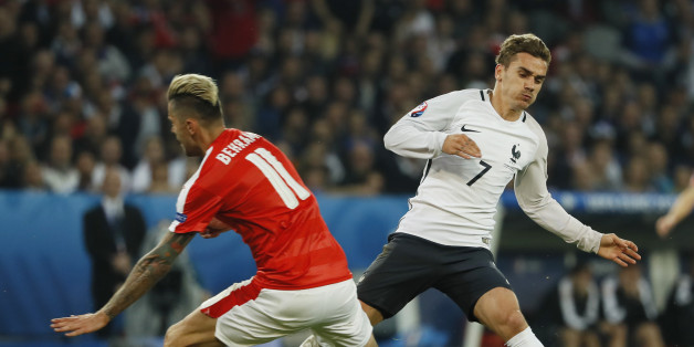 Football Soccer - Switzerland v France - EURO 2016 - Group A - Stade Pierre-Mauroy, Lille, France - 19/6/16Switzerland's Valon Behrami challenges France's Antoine Griezmann resulting in the ball to burstREUTERS/Gonzalo FuentesLivepic