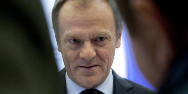 European Council President Donald Tusk speaks with journalists as he arrives at the European Council building in Brussels on Wednesday, Feb. 17, 2016. European Union leaders will hold a summit in Brussels on Thursday and Friday to hammer out a deal designed to keep Britain in the 28-nation bloc. (AP Photo/Virginia Mayo)