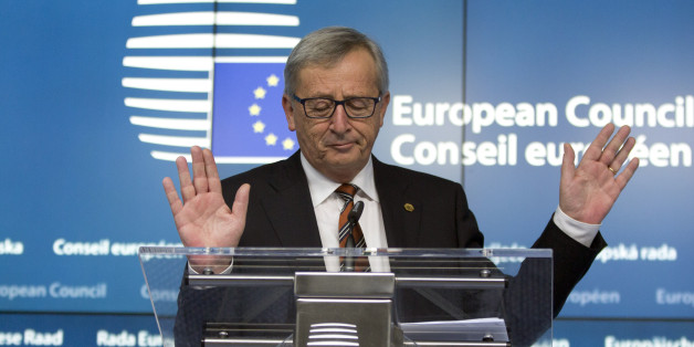 European Commission President Jean-Claude Juncker speaks during a media conference at an EU summit in Brussels on Friday, March 20, 2015. EU leaders on Friday are looking to back U.N.-brokered efforts to form a national unity government in conflict-torn Libya that may include a possible mission to help provide security. (AP Photo/Virginia Mayo)