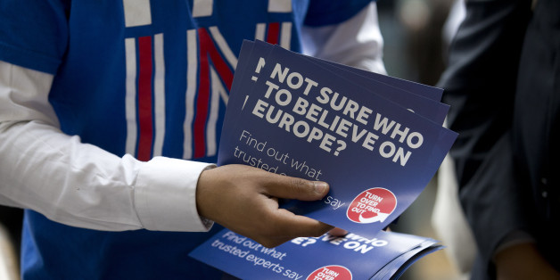 A campaigner hands out leaflets for 'Britain Stronger in Europe', the official 'Remain' campaign group seeking to avoid a Brexit outside Waterloo station, ahead of the forthcoming EU referendum in London on June 20, 2016. AFP PHOTO/JUSTIN TALLIS  / AFP / JUSTIN TALLIS        (Photo credit should read JUSTIN TALLIS/AFP/Getty Images)