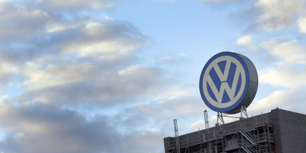FILE - In this Sept. 26, 2015 file photo a giant logo of the German car manufacturer Volkswagen is pictured on top of a company's factory building in Wolfsburg, Germany.  German prosecutors say they have widened their investigation of Volkswagen to include suspicion of tax evasion after revelations that some of its cars were emitting more carbon dioxide than officially reported. Braunschweig prosecutor Birgit Seel told The Associated Press on Tuesday  Nov. 24, 2015 that the investigation was focused on five Volkswagen employees but would not release their names. (AP Photo/Michael Sohn, file)