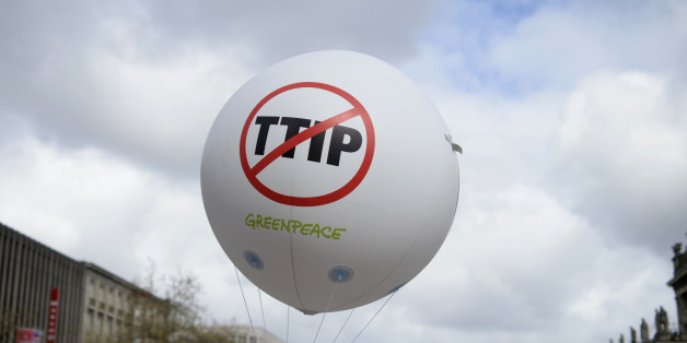 A Greenpeace air ballon with a protest sign is pictured during a demonstration against Transatlantic Trade and Investment Partnership (TTIP) free trade agreement ahead of U.S. President Barack Obama's visit in Hannover, Germany April 23, 2016.   REUTERS/Nigel Treblin