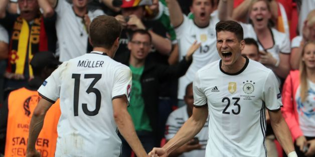 Germany's forward Mario Gomez (R) celebrates scoring the opening goal with Germany's midfielder Thomas Mueller during the Euro 2016 group C football match between Northern Ireland and Germany at the Parc des Princes stadium in Paris on June 21, 2016. / AFP / KENZO TRIBOUILLARD        (Photo credit should read KENZO TRIBOUILLARD/AFP/Getty Images)