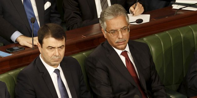 Tunisian's newly-appointed Tunisian Foreign Minister Khemaies Jhinaoui (L), Justice Minister Amor Mansour (R) and Interior Minister Hedi Majdoub (C) attend a plenary session at the Assembly of People's Representatives in Tunis, Tunisia January 11, 2016.  REUTERS/Zoubeir Souissi