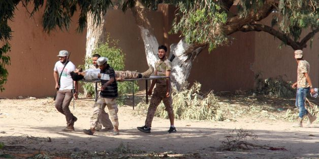Forces loyal to Libya's UN-backed unity government carry a comrade wounded during clashes with jihadists in the city of Sirte, 450 kilometres (280 miles) east of Tripoli, as they take part in an operation to recapture the city from the Islamic State (IS) group, on June 12, 2016.Forces allied with Libya's unity government, who entered Sirte on June 8 and have been advancing more quickly than expected against IS, which seized control of the coastal city last year and turned it into its main base o