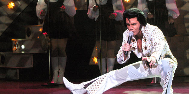 PARIS, FRANCE:  Canadian actor and singer Martin Fontaine performs as US singer Elvis Presley 06 November 2003 in Paris during the run-through of the Elvis Story show produced by the Capitole de Quebec theater. The show will run until 02 January 2004 at the Mogador theatre.  AFP PHOTO  FREDERICK FLORIN  (Photo credit should read FREDERICK FLORIN/AFP/Getty Images)