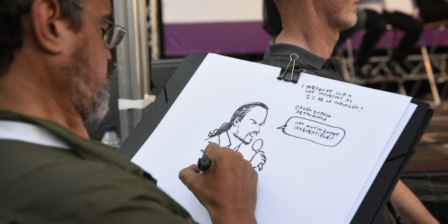 A man sketches a portrait of the leader of left wing party Podemos and party candidate for the upcoming general elections, Pablo Iglesias during a campaign meeting in Vitoria on June 21, 2016.  Spain is holding its second elections in six months, on June 26, after being governed by a caretaker government with limited powers since the December 20 polls put an end to the country's traditional two-party system as voters fed up with austerity and corruption scandals flocked to new groups. / AFP / ANDER GILLENEA        (Photo credit should read ANDER GILLENEA/AFP/Getty Images)