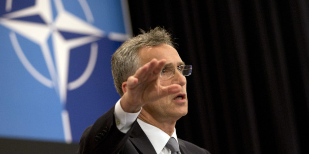 NATO Secretary General Jens Stoltenberg speaks during a media conference at NATO headquarters in Brussels on Monday, June 13, 2016. NATO's chief says the alliance will agree this week to send four multinational battalions to the Baltic states and Poland to boost their defenses against Russia. (AP Photo/Virginia Mayo)
