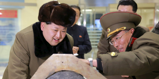 FILE PHOTO: North Korean leader Kim Jong Un looks at a rocket warhead tip after a simulated test of atmospheric re-entry of a ballistic missile, at an unidentified location in this undated photo released by North Korea's Korean Central News Agency (KCNA) in Pyongyang on March 15, 2016.    KCNA/File Photo via REUTERS  ATTENTION EDITORS - THIS IMAGE WAS PROVIDED BY A THIRD PARTY. EDITORIAL USE ONLY. REUTERS IS UNABLE TO INDEPENDENTLY VERIFY THIS IMAGE. NO THIRD PARTY SALES. SOUTH KOREA OUT. NO COM