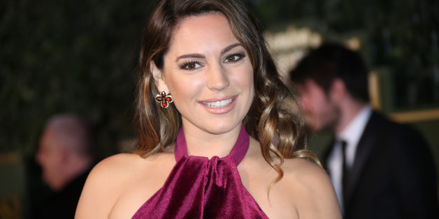 Kelly Brook poses for photographers upon arrival the Evening Standard Theatre Awards in London, Sunday, Nov. 22, 2015. (Photo by Joel Ryan/Invision/AP)