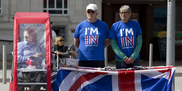 Campaigners for 'Britain Stronger in Europe', the official 'Remain' campaign group stand by their stand in Clacton-on-Sea as UK Independence Party (UKIP) leader Nigel Farage visits on June 21, 2016.Britain goes to the polls in two days to vote on whether to remain or leave the EU with the result too close to call. / AFP / JUSTIN TALLIS        (Photo credit should read JUSTIN TALLIS/AFP/Getty Images)