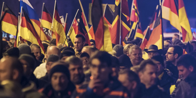 People hold flags in Erfurt, central Germany, Wednesday, March 16, 2016, during a demonstration initiated by the Alternative for Germany (AfD) party against the immigration situation. (AP Photo/Jens Meyer)