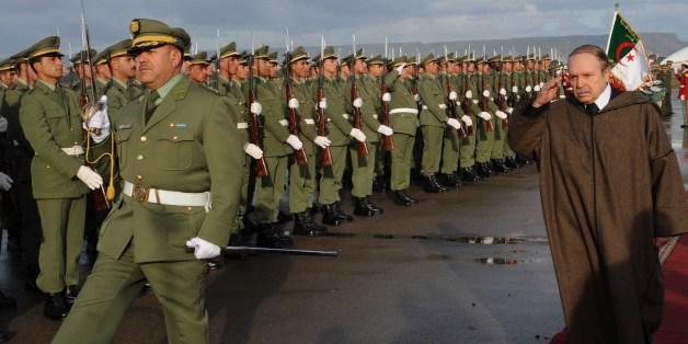 President Abdelaziz Bouteflika reviews an honor guard upon his arrival at Oran airport on December 16, 2008.