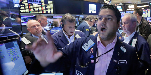 Specialist Ronnie Howard, foreground, works with traders at his post on the floor of the New York Stock Exchange, Friday, June 24, 2016. U.S. stocks are plunging in early trading after Britons voted to leave the European Union. (AP Photo/Richard Drew)