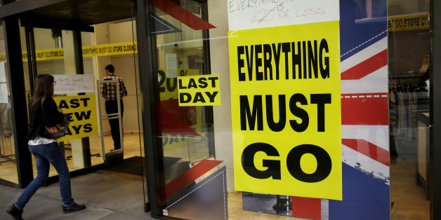 "A store closing sale banner stating ""Everything Must Go"" on a window next to the colors of the Union flag in the City of London, Friday, June 24, 2016. Britain's Prime Minister David Cameron announced Friday that he will quit as Prime Minister following a defeat in the referendum which ended with a vote for Britain to leave the European Union. (AP Photo/Matt Dunham)"