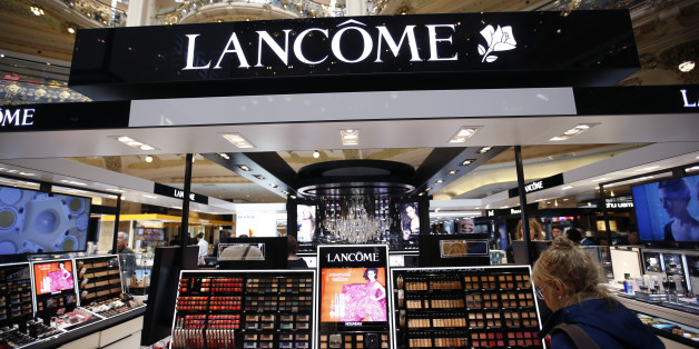 A woman stands in front of a Lancome counter, the cosmetics and perfume brand of French cosmetics group L'Oreal, at a department store in Paris April 20, 2015. L'Oreal posted a 14.1 percent rise in first-quarter sales on Monday, helped by the weak euro and resilient demand for luxury goods products such as Yves Saint Laurent's Black Opium perfume.  REUTERS/Charles Platiau