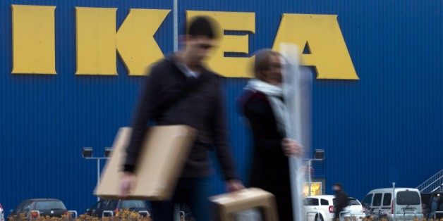 People walk in front of an IKEA shop in Berlin, Friday, Nov. 16, 2012. Swedish furniture giant Ikea expressed regret Friday that it benefited from the use of forced prison labor by some of its suppliers in communist East Germany more than two decades ago. (AP Photo/Markus Schreiber)