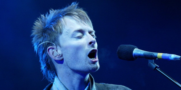 Thom Yorke, lead singer of 'Radiohead' performs at the Glastonbury Festival, Somerset, June 28, 2003. [The annual music and arts festival attracts over one hundred thousand festival goers, with musical highlights being REM  and Radiohead playing.]
