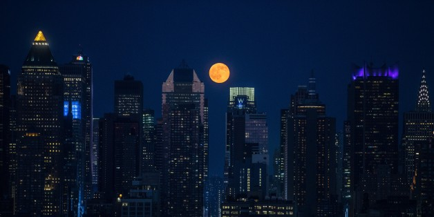 NEW YORK, NY - JUNE 20: The full moon rises above the skyscrapers in Manhattan, New York on June 20, 2016. For the first time since the Summer of Love in 1967, June's full moon, also known as the Strawberry Moon, coincided with the summer solstice. (Photo by Volkan Furuncu/Anadolu Agency/Getty Images)