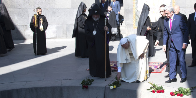 Pope Francis, second right, flanked by Catholicos Karekin II, left, and Armenia's President Serzh Sargsyan, right, places flowers during his visit to Tzitzernakaberd Memorial Complex in Yerevan, Armenia, Saturday,  June 25, 2016. (Maurizio Brambatti/Pool Photo via AP)