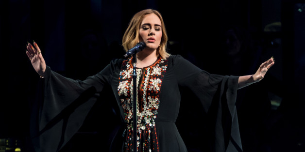GLASTONBURY, ENGLAND - JUNE 25:  Adele performs on The Pyramid Stage on day 2 of the Glastonbury Festival at Worthy Farm, Pilton on June 25, 2016 in Glastonbury, England. Now its 46th year the festival is one largest music festivals in the world and this year features headline acts Muse, Adele and Coldplay. The Festival, which Michael Eavis started in 1970 when several hundred hippies paid just £1, now attracts more than 175,000 people.  (Photo by Ian Gavan/Getty Images)