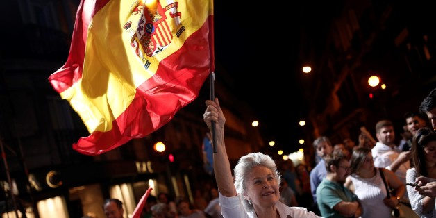 MADRID, SPAIN - JUNE 26: Popular Party supporters wave flags outside their headquarters after polls closed in the Spanish general election on June 26, 2016 in Madrid, Spain. (Photo by Burak Akbulut/Anadolu Agency/Getty Images)