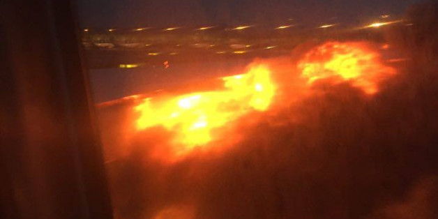 "This image provided by Lee Bee Yee shows an engine on fire on a Singapore Airlines flight on Monday, June 27, 2016. A Singapore Airlines statement said the Boeing 777-300ER was on its way to Milan when it turned back ""following an engine oil warning message."" It says the aircraft's right engine caught fire after Flight SQ368 touched down more than four hours after takeoff. (Lee Bee Yee via AP)"