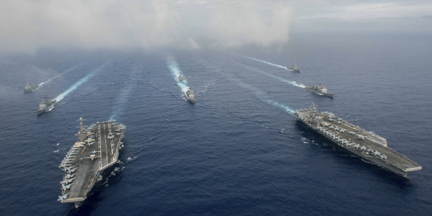 The Nimitz-class aircraft carriers USS John C. Stennis (CVN 74), and USS Ronald Reagan (CVN 76) (R) conduct dual aircraft carrier strike group operations in the U.S. 7th Fleet area of operations in support of security and stability in the Indo-Asia-Pacific in the Philippine Sea on June 18, 2016.   Courtesy Jake Greenberg/U.S. Navy/Handout via REUTERS   ATTENTION EDITORS - THIS IMAGE WAS PROVIDED BY A THIRD PARTY. EDITORIAL USE ONLY