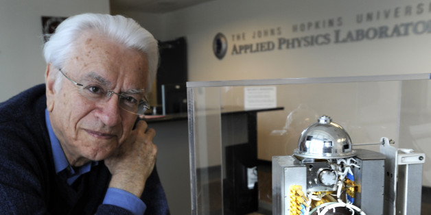 Stamatios M. Krimigis, of the Johns Hopkins University Applied Physics Laboratory, is pictured with the Voyager spacecraft's backup flight unit, which was never used, January 10, 2011, in Laurel, Maryland. (Jed Kirschbaum/Baltimore Sun/MCT via Getty Images)