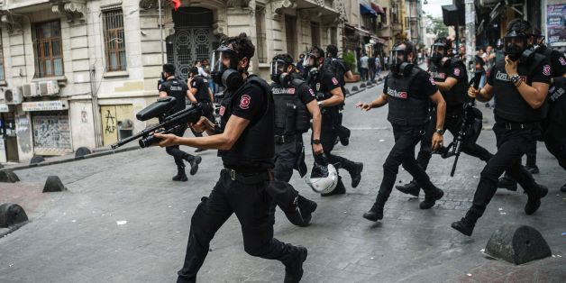 Turkish anti riot police officers fire rubber bullets to disperse demonstrators gathered for a rally staged by the LGBT community on Istiklal avenue in Istanbul on June 26, 2016.
