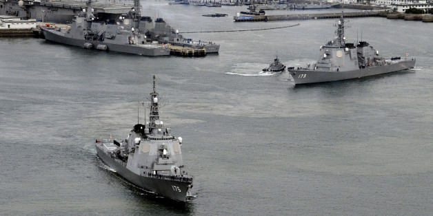 Japan Maritime Self-Defense Force's (JMSDF) Aegis destroyers Myoko (L) and Kongo sail off from the JMSDF Sasebo base in Sasebo, southern Japan, in this photo taken by Kyodo December 6, 2012. Japan's Defence Ministry plans to deploy three Aegis destroyers armed with SM-3 missile interceptors in the East China Sea and the Sea of Japan in response to North Korea's plan to launch the rocket between December 10 and 22, Kyodo news reports. They left Sasebo in Nagasaki prefecture on Thursday morning. M