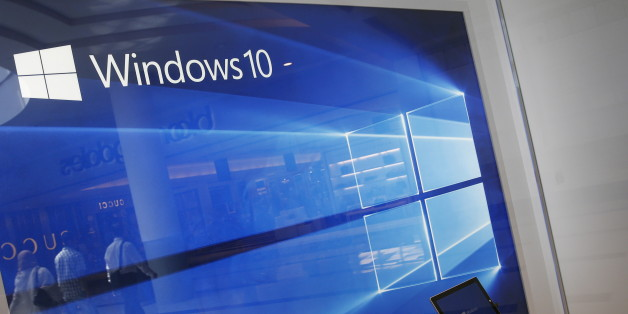 A display for the Windows 10 operating system is seen in a store window at the Microsoft store at Roosevelt Field in Garden City, New York July 29, 2015. Microsoft Corp's launch of its first new operating system in almost three years, designed to work across laptops, desktop and smartphones, won mostly positive reviews for its user-friendly and feature-packed interface.REUTERS/Shannon Stapleton