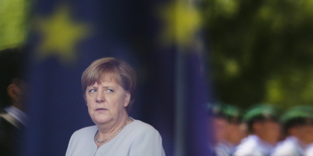 In this photo taken through a window with the reflection of an European flag German Chancellor Angela Merkel waits for the Prime Minister of the Ukraine Volodymyr Groysman at the chancellery in Berlin, Monday, June 27, 2016. Merkel later on Monday meets French President Francois Hollande, Italian Prime Minister Matteo Renzi and European Council President Donald Tusk, ahead of an EU-wide summit Tuesday and Wednesday. (AP Photo/Markus Schreiber)