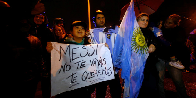 """A boy holds a sign that reads """"Messi, don't go, we love you"""" as he waits for Argentina's soccer team to arrive to their training camp after their participation in the 2016 Copa America Centenario, in Buenos Aires, Argentina, June 27, 2016.  REUTERS/Marcos Brindicci"""