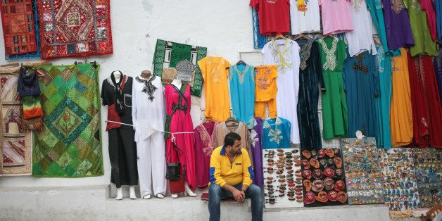 A shop owner waits for tourists outside his shop at the touristic village of Sidi Bou Said, some 20 kilometers outside of Tunis, Tunisia, Sunday, Oct. 25, 2015. (AP Photo/Mosa'ab Elshamy)