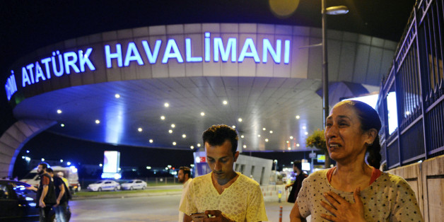 People gather on the entrance to Istanbul's Ataturk airport, early Wednesday, June 29, 2016. Suspected Islamic State group extremists have hit the international terminal of Istanbul's Ataturk airport, killing dozens of people and wounding many others, Turkish officials said Tuesday. Turkish authorities have banned distribution of images relating to the Ataturk airport attack within Turkey. (AP Photo/Emrah Gurel) TURKEY OUT