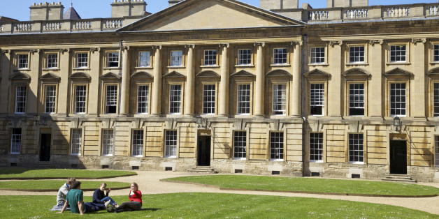 Students sitting outside in spring sunshine, Peckwater Quadrangle, designed by Henry Aldrich, Christ Church, Oxford University, Oxford, Oxfordshire, England, United Kingdom, Europe