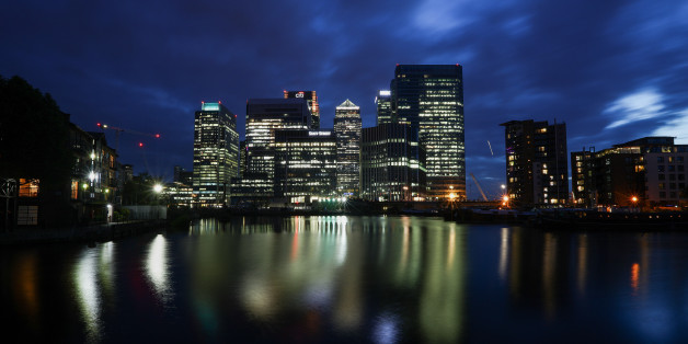 The No. 1 Canada Square skyscraper, center, stands surrounded by office buildings illuminated at night in the Canary Wharf financial, shopping and business district on the banks of the River Thames in London, U.K., on Tuesday, June 21, 2016. Financial and related services accounted for 11.8 percent of U.K. economic output, or 190 billion pounds ($278 billion), in 2014, and quitting the EU could cost as many as 100,000 jobs in the sector by 2020, according to industry group TheCityUK. Photographe