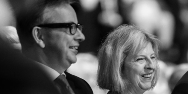 MANCHESTER, ENGLAND - OCTOBER 02:  (EDITOR'S NOTE: Image was processed using digital filters. Colour version not available) Cabinet Ministers Michael Gove (L), Theresa May and George Osborne laugh as  British Prime Minister David Cameron delivers his keynote speech to delegates on the last day of the annual Conservative Party Conference at Manchester Central on October 2, 2013 in Manchester, England. During his closing speech David Cameron said that his 'abiding mission' would make the UK into a 'land of opportunity'.  (Photo by Christopher Furlong/Getty Images)