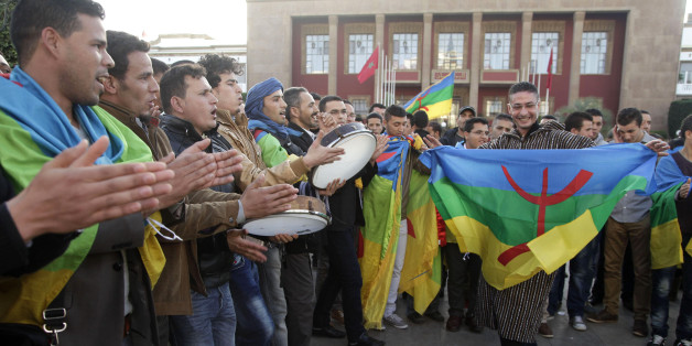 Members of the Moroccan Amazigh Berber community sing and wave the Amazigh flag as they celebrate on the eve of the 2964th Amazigh new year near the parliament in Rabat January 12, 2014. REUTERS/Stringer (MOROCCO - Tags: ANNIVERSARY POLITICS)
