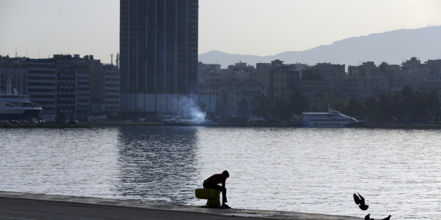 A migrant sits at the Athens port of Piraeus, Monday April 4, 2016, during the first day of the implementation of the deal between EU and Turkey. Under the deal, migrants arriving illegally in Greece will be returned to Turkey if they do not apply for asylum or if they make an asylum claim that is rejected. (AP Photo/Lefteris Pitarakis)