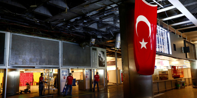 Workers repair the damaged parts of the terminal building at Turkey's largest airport, Istanbul Ataturk, Turkey, following Tuesday's blast, June 29, 2016. REUTERS/Murad Sezer