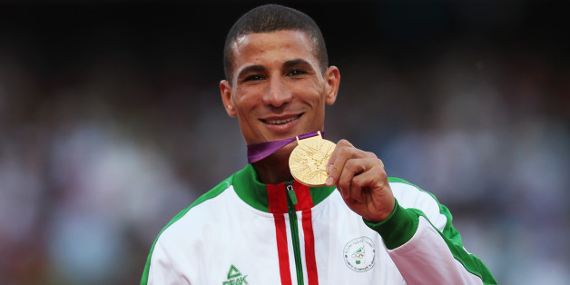 LONDON, ENGLAND - AUGUST 08:  Gold medalist Taoufik Makhloufi of Algeria poses on the podium during the medal ceremony for the Men's 1500m on Day 12 of the London 2012 Olympic Games at Olympic Stadium on August 8, 2012 in London, England.  (Photo by Quinn Rooney/Getty Images)