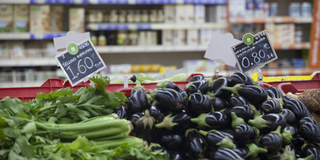 Euro price signs sit on vegetables, including celery, left, and aubergines, right, for sale inside a Carrefour SA supermarket, part of the Marinopoulos Group, in Limassol, Cyprus, on Monday, Sept. 8, 2014. The Cypriot economy contracted 0.3% in 2Q from previous quarter, vs 0.6% q/q drop in 1Q, according to seasonally adjusted estimates posted on Cyprus Statistical Service website. Photographer: Andrew Caballero-Reynolds/Bloomberg via Getty Images