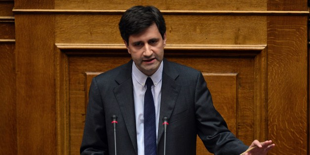 Greek Deputy Finance Minister Giorgos Chouliarakis addresses lawmakers during a parliament session prior the confidence vote of the new government at the Greek parliament in Athens late on October 7, 2015. AFP PHOTO/ LOUISA GOULIAMAKI        (Photo credit should read LOUISA GOULIAMAKI/AFP/Getty Images)
