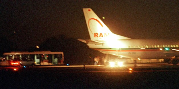 Passengers are seen disembarking from a Royal Air Maroc Boeing 737 early Thursday morning Aug. 26, 1999, at Barcelona airport, Spain, following a hijacking. The plane, carrying 88 passengers and crew was en route from Casablanca, Morocco, to Tunis, Tunisia, when it was forced to divert to Spain. No one was injured and no motive was given was the hijacking. (AP Photo/Cesar Rangel)